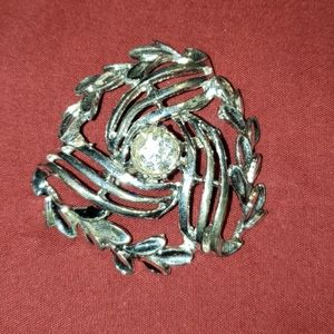 Large silver brooch with single rhinestone and ivy